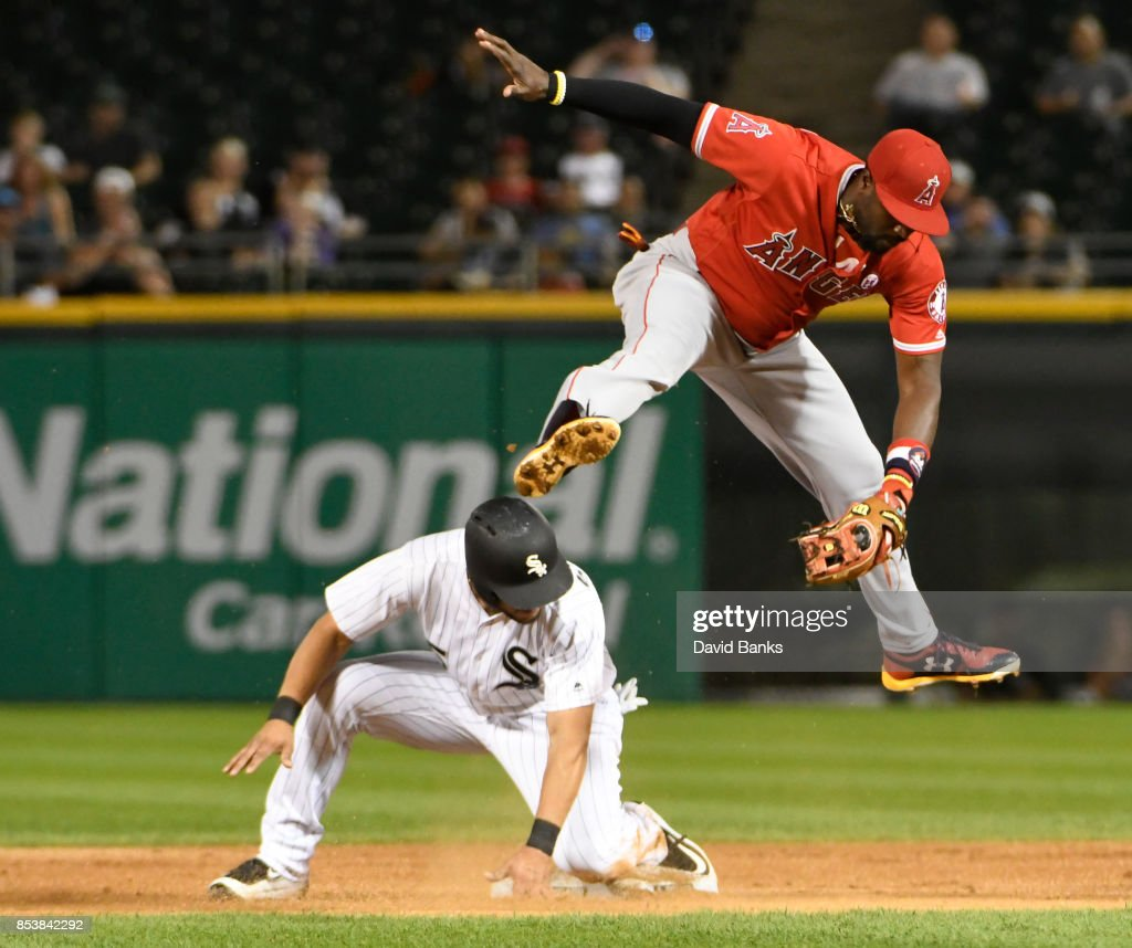 Alfredo Griffin #4 of the Los Angeles Angels of Anaheim leaps for the ball as Yolmer Sanchez #5 of the Chicago White Sox is safe at second base during the first inning on September 25, 2017 at Guaranteed Rate Field in Chicago, Illinois.