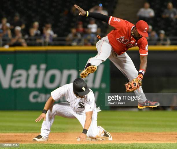 Alfredo Griffin of the Los Angeles Angels of Anaheim leaps for the ball as Yolmer Sanchez of the Chicago White Sox is safe at second base during the...