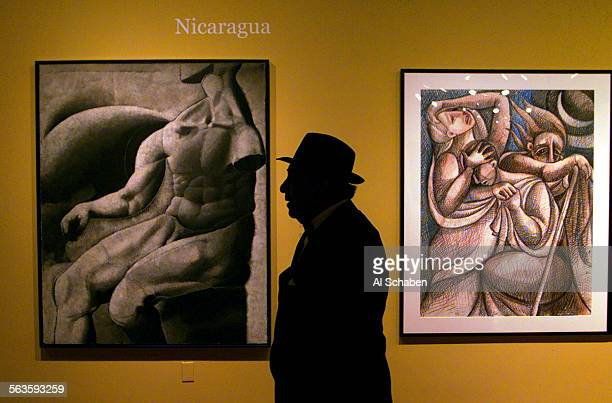Alfredo Herrera Sr of Mexico City views Latin American artwork on display while attending the Long beach symphony sponsored gala benefit dinner where...