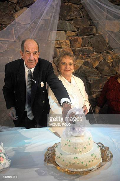 Alfredo Maciel and Nilsa Noble cut their wedding cake after getting married at the public geriatric hospital Pieyro del Campo in which they both live...