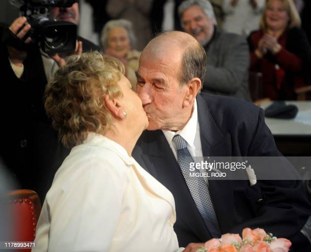 Alfredo Maciel and Nilsa Noble kiss just after getting married at the public geriatric hospital Piñeyro del Campo in which they both live in...