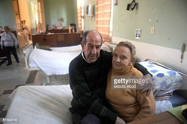 Alfredo Maciel and Nilsa Noble pose together at one of the rooms of the public geriatric hospital Pieyro del Campo in which they both live in...