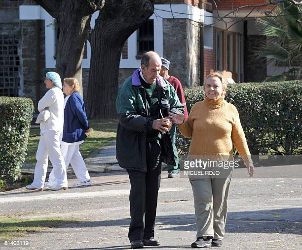Alfredo Maciel and Nilsa Noble take a walk at the public geriatric hospital Pieyro del Campo in which they both live in Montevideo Uruguay just hours...