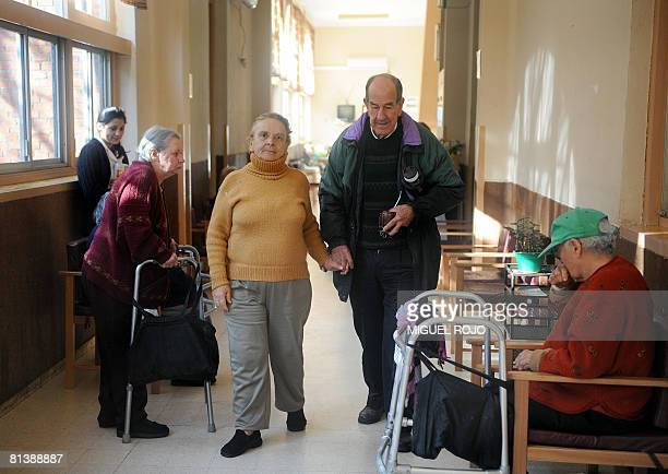 Alfredo Maciel and Nilsa Noble walk hand in hand along one of the corridors of the public geriatric hospital Pieyro del Campo in which they both live...