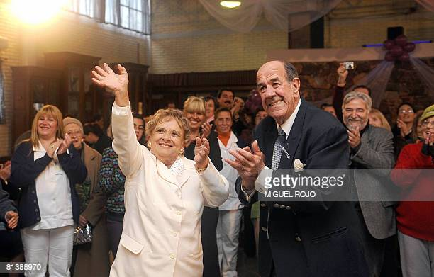Alfredo Maciel and Nilsa Noble wave just after getting married at the public geriatric hospital Pieyro del Campo in which they both live in...