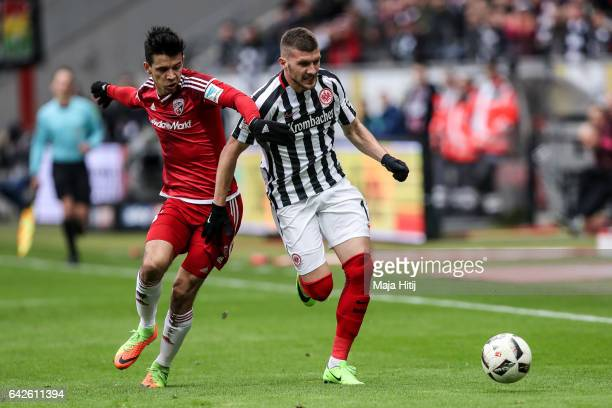 Alfredo Morales and Ante Rebic of Frankfurt battle for the ball during the Bundesliga match between Eintracht Frankfurt and FC Ingolstadt 04 at...