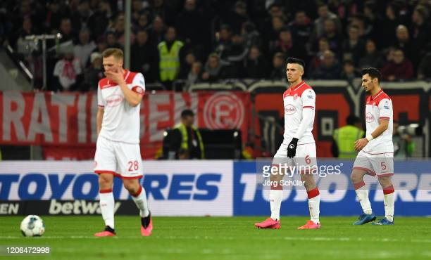 Alfredo Morales and Kaan Ayhan of Fortuna Dusseldorf look dejected after their team concede during the Bundesliga match between Fortuna Duesseldorf...