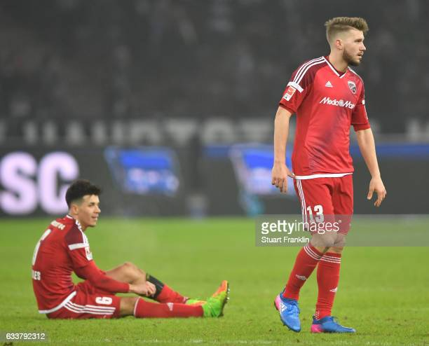 Alfredo Morales and Robert Leipertz of Ingolstadt look dejected the Bundesliga match between Hertha BSC and FC Ingolstadt 04 at Olympiastadion on...