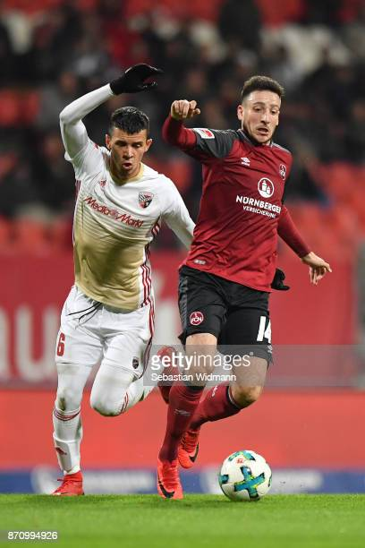 Alfredo Morales of FC Ingolstadt 04 and Kevin Moehwald of 1FC Nuernberg compete for the ball during the Second Bundesliga match between 1 FC...
