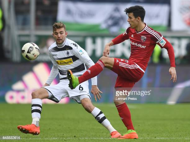 Alfredo Morales of FC Ingolstadt 04 challenges Christoph Kramer of Borussia Moenchengladbach during the Bundesliga match between FC Ingolstadt 04 and...