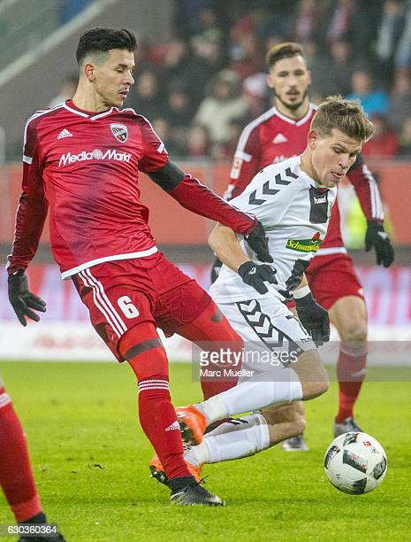 Alfredo Morales of FC Ingolstadt 04 is challenged by Florian Niederlechner of SC Freiburg during the Bundesliga match between FC Ingolstadt 04 and SC...