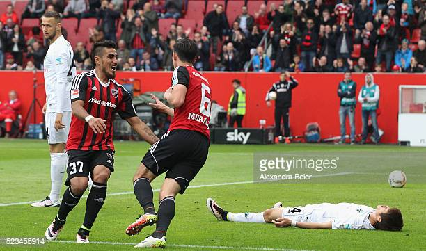 Alfredo Morales of FC Ingolstadt celebrates his first goal with teammate Dario Lezcano Farina as players of Hanover react during the Bundesliga match...