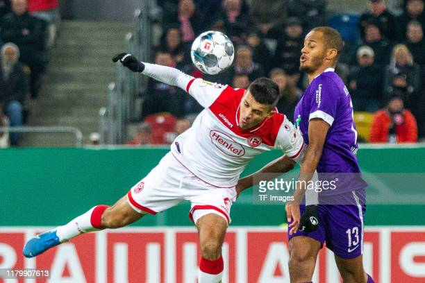 Alfredo Morales of Fortuna Duesseldorf and Louis Samson of Erzgebirge Aue battle for the ball during the DFB Cup second round match between Fortuna...