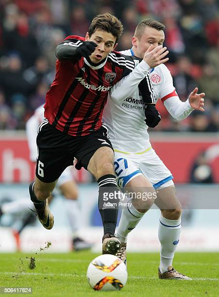 Alfredo Morales of Ingolstadt 04 is challenged by Christian Clemens of FSV Mainz 05 during the Bundesliga match between FC Ingolstadt and FSV Mainz...