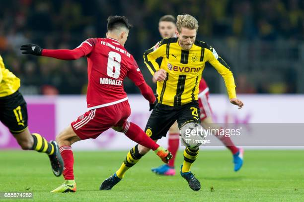 Alfredo Morales of Ingolstadt and Andre Schuerrle of Dortmund battle for the ball during the Bundesliga match between Borussia Dortmund and FC...