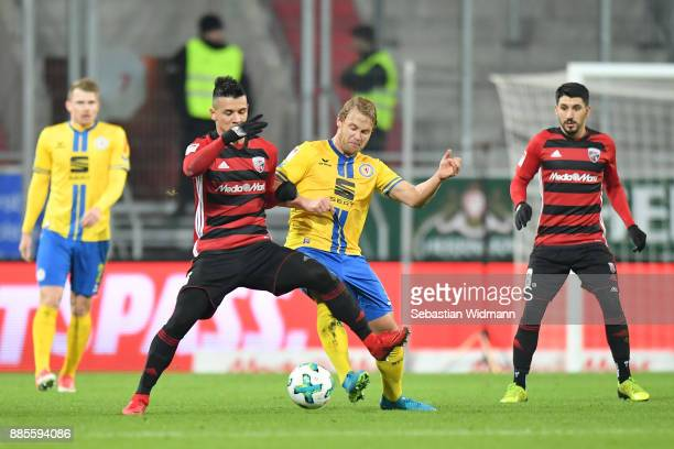 Alfredo Morales of Ingolstadt and Jan Hochscheidt of Braunschweig compete for the ball during the Second Bundesliga match between FC Ingolstadt 04...