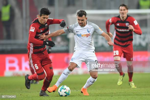 Alfredo Morales of Ingolstadt and Kevin Stoeger of Bochum compete for the ball during the Second Bundesliga match between FC Ingolstadt 04 and VfL...
