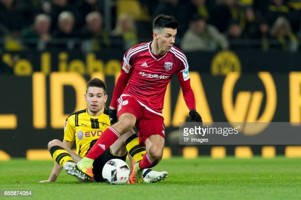 Alfredo Morales of Ingolstadt and Raphael Guerreiro of Dortmund battle for the ball during the Bundesliga match between Borussia Dortmund and FC...