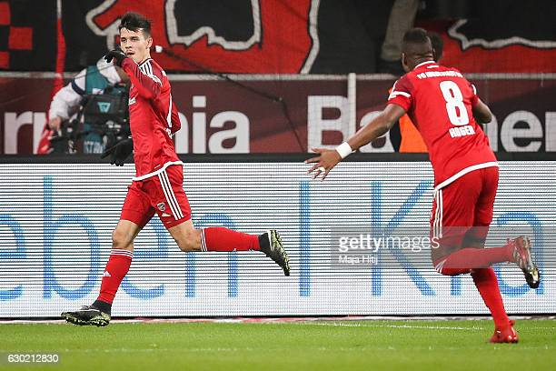 Alfredo Morales of Ingolstadt celebrates with Roger after scoring his team's first goal to make it 01 during the Bundesliga match between Bayer 04...