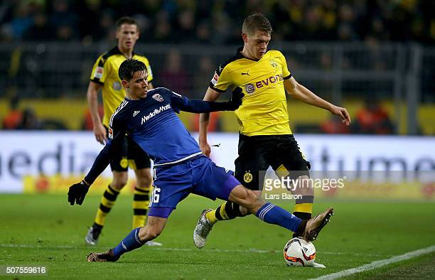 Alfredo Morales of Ingolstadt challenges Matthias Ginter of Dortmund during the Bundesliga match between Borussia Dortmund and FC Ingolstadt at...