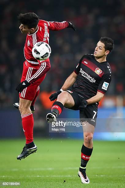 Alfredo Morales of Ingolstadt is challenged by Chicharito of Leverkusen during the Bundesliga match between Bayer 04 Leverkusen and FC Ingolstadt 04...