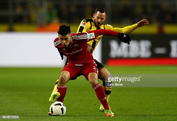 Alfredo Morales of Ingolstadt is challenged by Gonzalo Castro of Dortmund during the Bundesliga match between Borussia Dortmund and FC Ingolstadt 04...