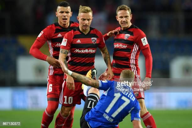 Alfredo Morales Sonny Kittel and Marcel Gaus of Ingolstadt tackle Christoph Hemlein of Bielefeld during the Second Bundesliga match between DSC...