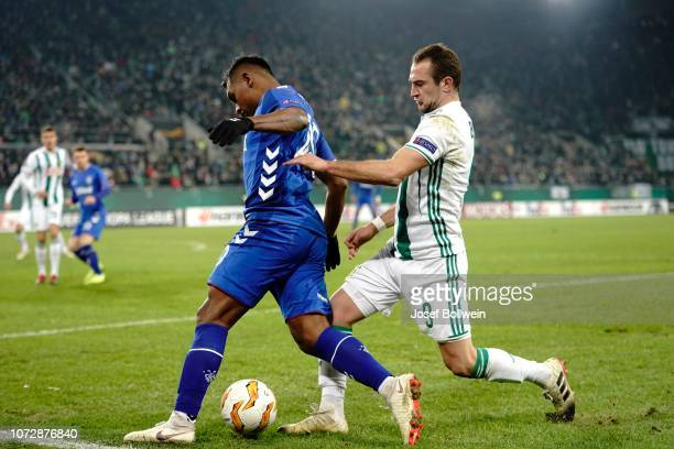 Alfredo Morelos of Rangers and Veton Berisha of Rapid during the UEFA Europa League match between SK Rapid Wien v Rangers at Weststadion on December...