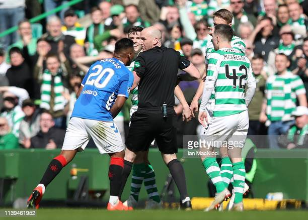 Alfredo Morelos of Rangers argues with match Referee Bobby Madden after he is shown the red card for a tackle on Scott Brown of Celtic during the...