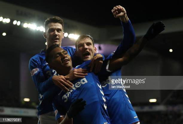 Alfredo Morelos of Rangers celebrates with Borna Barisic and Ryan Jack after scores the opening goal during the Scottish Cup 5th Round Replay between...