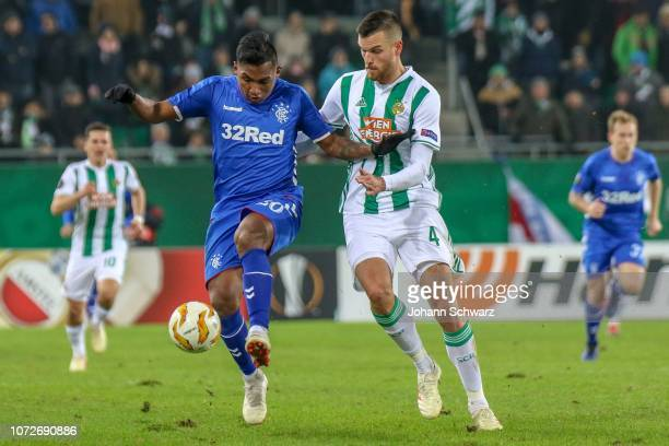 Alfredo Morelos of Rangers challenges Mateo Barac of Rapid during the UEFA Europa League match between Rapid Wien and Rangers at Weststadion on...