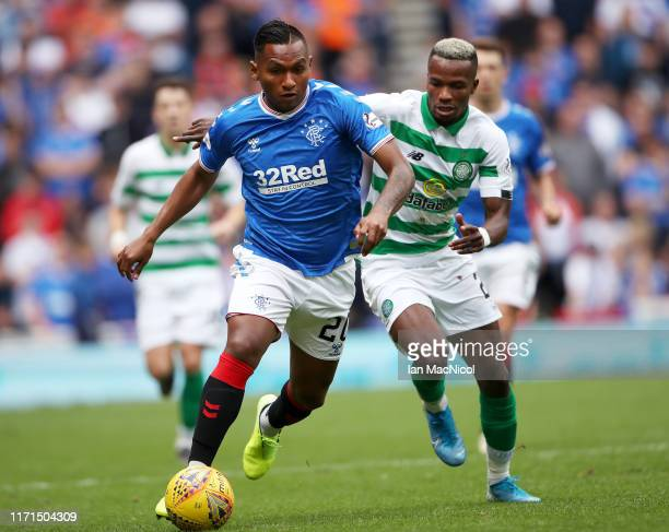 Alfredo Morelos of Rangers FC is challenged by Boli Bolingoli of Celtic during the Ladbrokes Premiership match between Rangers and Celtic at Ibrox...