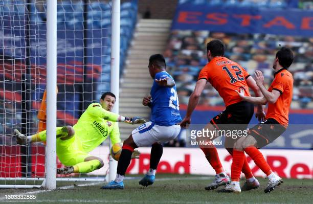 Alfredo Morelos of Rangers has a shot saved by Benjamin Siegrist of Dundee United during the Ladbrokes Scottish Premiership match between Rangers and...