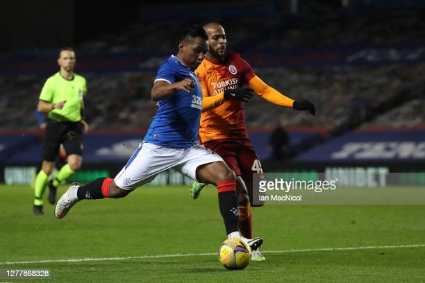 Alfredo Morelos of Rangers is challenged by Marcao of Galatasaray during the UEFA Europa League play-off match between Rangers and Galatasaray at...