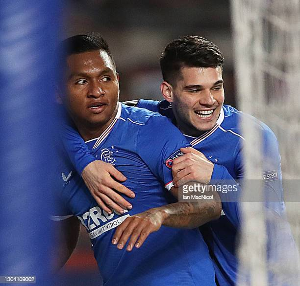 Alfredo Morelos of Rangers is congratulated by Ianis Hagi after scoring the opening goal during the UEFA Europa League Round of 32 match between...