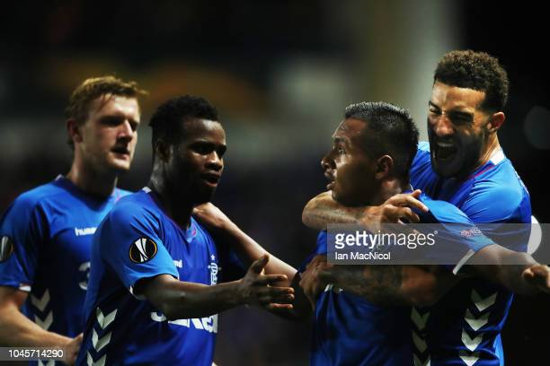 Alfredo Morelos of Rangers is congratulated by team mates after he scores his team's first goal during the UEFA Europa League Group G match between...