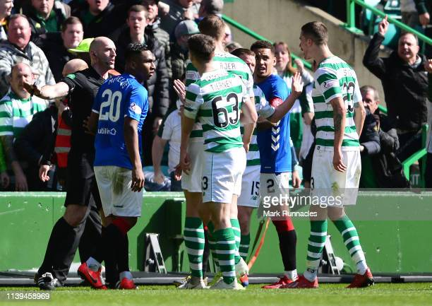 Alfredo Morelos of Rangers is given the red card by match referee Bobby Madden after a challenge on Scott Brown of Celtic during the Ladbrokes...