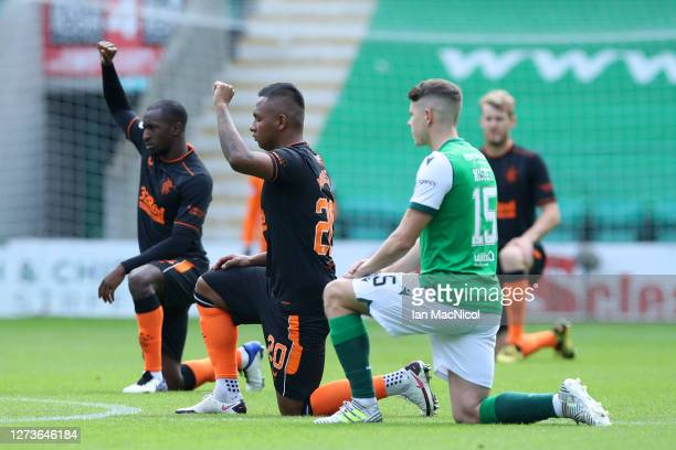Alfredo Morelos of Rangers takes the knee in support of the Black Lives Matter Movement prior to the Scottish Premiership match between Hibernian and...