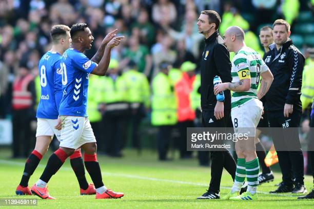 Alfredo Morelos of Rangers walks off the pitch after he is given the red card by match referee Bobby Madden after a challenge on Scott Brown of...