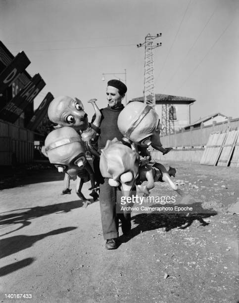Alfredo Pardini creator of the Notte de Carnevale float for the Carnival of Viareggio in Tuscany Italy with some of his creations 1951