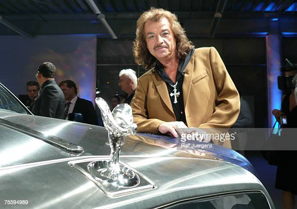 Alfredo Pauly poses behind the new Rolls Royce Cabrio at his unveiling at BMW Hammer in Cologne Germany