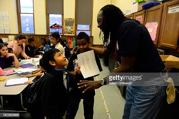 Alfredo Reyes jokes with Rev. Leon Kelly about his homework during Open Doors after school program at Wyatt Elementary School. The program, which...