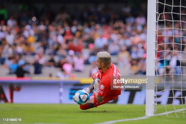 Alfredo Saldivar of Pumas catches a ball from a penalty kick by Joel Campbell of Leon during the 8th round match between Pumas UNAM and Leon as part...