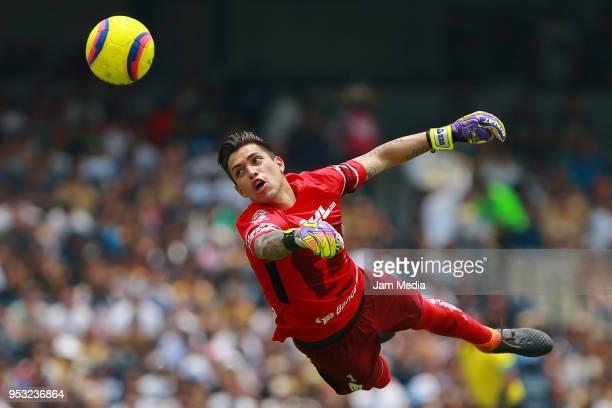 Alfredo Saldivar of Pumas dives for the ball during the 17th round match between Pumas UNAM and Queretaro as part of the Torneo Clausura 2018 Liga MX...