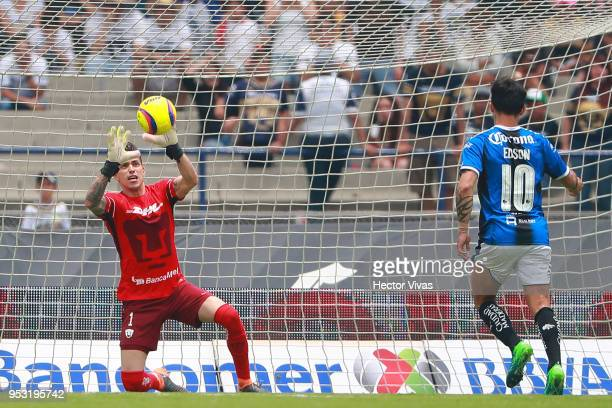 Alfredo Saldivar of Pumas stops a penalty shot kicked by Edson Puch of Queretaro during the 17th round match between Pumas UNAM and Queretaro as part...