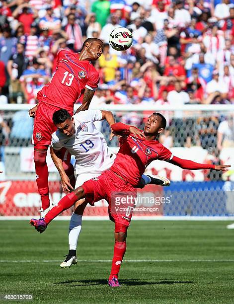Alfredo Stephens and Marcos Sanchez of Panama win the ball against Miguel Ibarra of the USA in the first half of their international men's friendly...