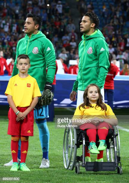 Alfredo Talavera and Diego Reyes of Mexico line up for the national anthems prior to the FIFA Confederations Cup Russia 2017 Group A match between...