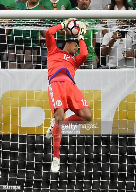 Alfredo Talavera goalkeeper of Mexico makes a save during a group C match between Mexico and Uruguay at University of Phoenix Stadium as part of Copa...