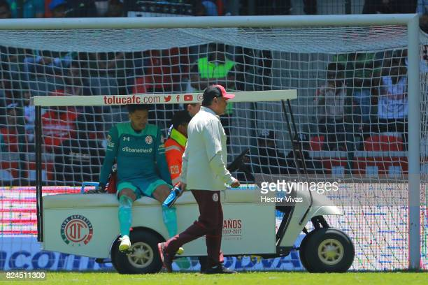 Alfredo Talavera goalkeeper of Toluca leaves the field after being injured during the 2nd round match between Toluca and Leon as part of the Torneo...