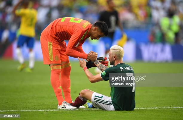 Alfredo Talavera of Mexico consoles teammate Miguel Layun of Mexico following their sides defeat in the 2018 FIFA World Cup Russia Round of 16 match...